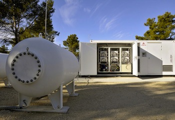 The Greenergy Box energy storage system from Areva. Consisting of an electrolyser and a fuel cell, it stores hydrogen and oxygen generated by water electrolysis when power demand is low and recombines them to produce electricity when power demand is high. Photo credit: Areva